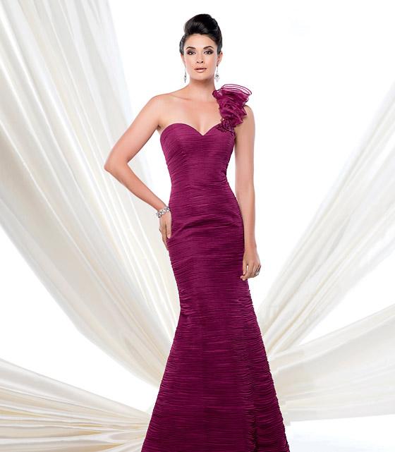 Woman wearing a bridesmaid dress.
